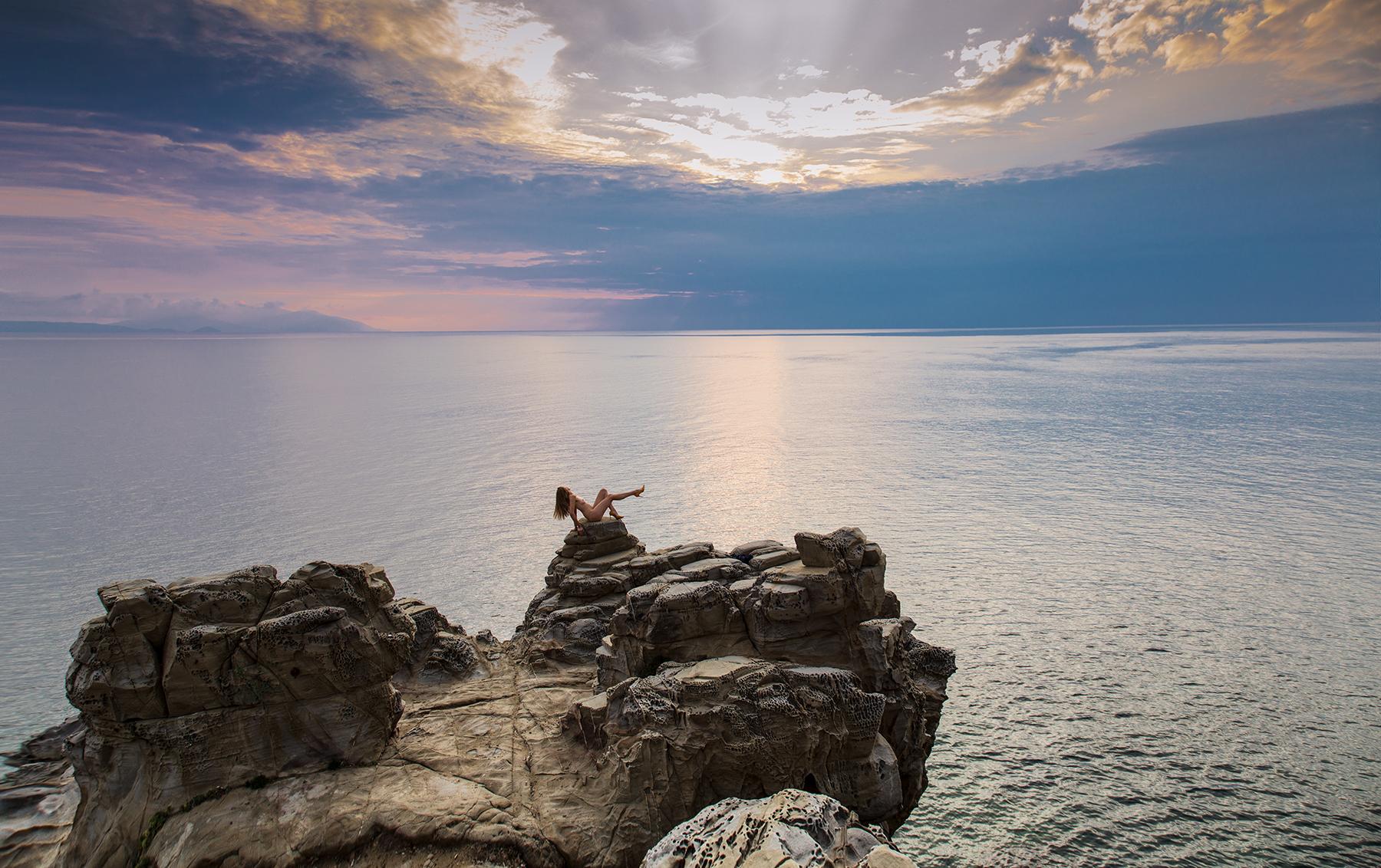 high-heeled woman on sea cliffwoman